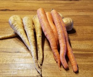 carrots and parsnips on butcher board